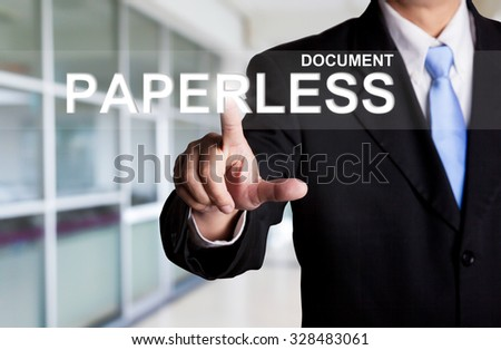business, technology, internet and networking concept - businessman pressing document paperless button on virtual screens - stock photo
