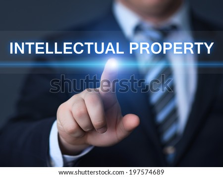 business, technology, internet and networking concept - businessman pressing intellectual property button on virtual screens - stock photo