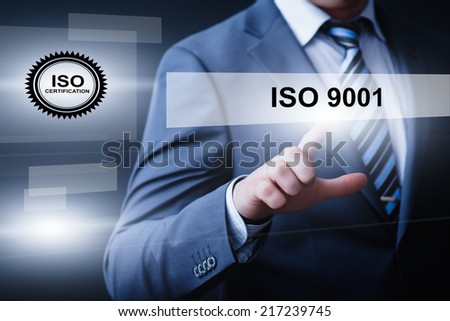business, technology, internet and networking concept - businessman pressing iso 9001 button on virtual screens