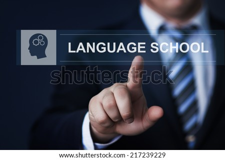 business, technology, internet and networking concept - businessman pressing language school button on virtual screens - stock photo
