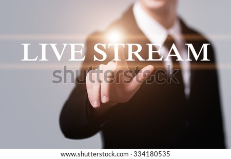 business, technology, internet and networking concept - businessman pressing live stream button on virtual screens - stock photo