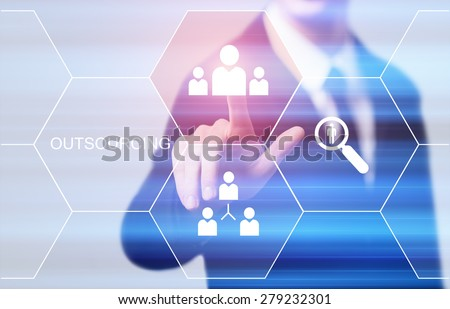 business, technology, internet and networking concept - businessman pressing outsourcing button on virtual screens - stock photo