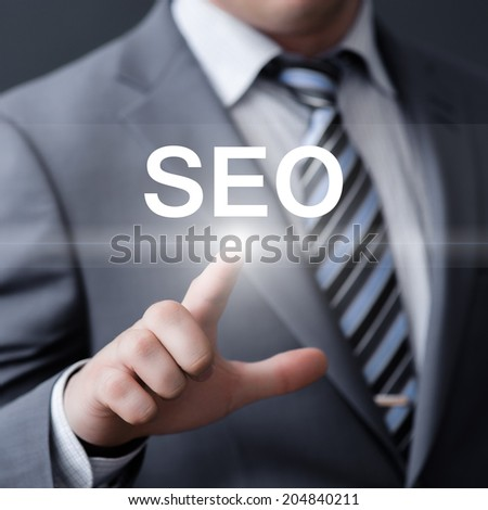 business, technology, internet and networking concept - businessman pressing seo button on virtual screens - stock photo