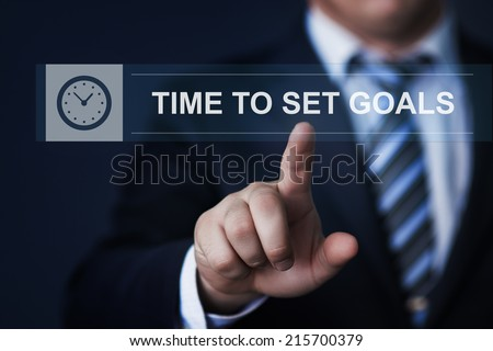 business, technology, internet and networking concept - businessman pressing time to set goals button on virtual screens - stock photo
