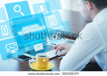 Business, technology, internet and networking concept. Young businessman working on his laptop in the office, select the icon digital technology on the virtual display. - stock photo