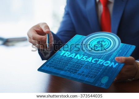 Business, technology, internet and networking concept. Young businessman working on his tablet in the office, select the icon transaction on the virtual display. - stock photo