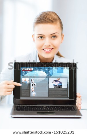 business, technology, internet and news concept - woman showing laptop pc with news app - stock photo