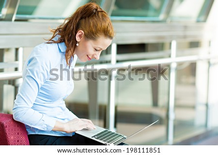Business, technology, internet hotel concept. Closeup portrait happy smiling businesswoman, tablet pc computer, working checking email isolated background corporate office hallway. Positive expression - stock photo