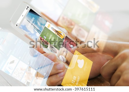 business, technology, mass media and people concept - close up of male hand holding transparent smartphone with internet news web page on screen - stock photo