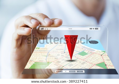business, technology, navigation, location and people concept - close up of male hand holding and showing transparent smartphone with gps navigator map - stock photo