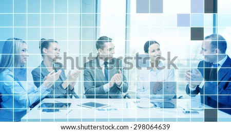 business, technology, success and people concept - happy business team with laptop computers, documents and coffee clapping hand over blue squared grid background - stock photo
