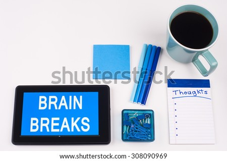 Business Term / Business Phrase on Tablet PC - Blue Colors, Coffee, Pens, Paper Clips and note pads on White - White Word(s) on blue - Brain Breaks - stock photo