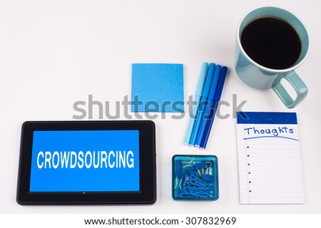 Business Term / Business Phrase on Tablet PC - Blues, cup of coffee, Pens, paper clips Calculator with a blue note pad on White - White Word(s) on blue - Crowdsourcing - stock photo
