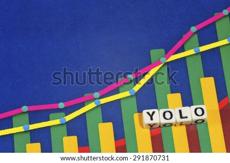 Business Term with Climbing Chart / Graph - YOLO - stock photo