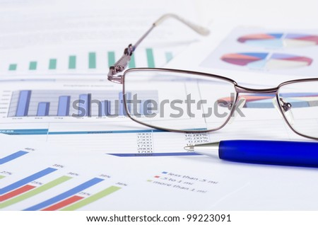 Business the newspaper with chart - stock photo