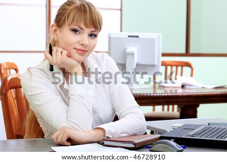 Business theme: beautiful businesswoman working at the office. - stock photo