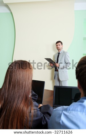 Business theme: business people on a presentation.
