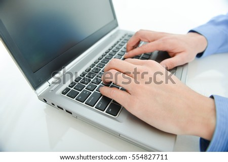 Business theme photo of person working on a laptop