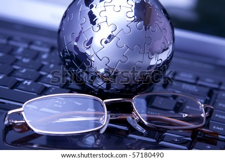 Business theme with laptop, glasses