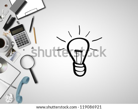 business things and drawing lamp - stock photo