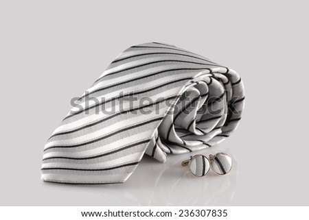 business tie and cufflinks on White - stock photo