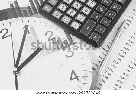 Business time concept, calculator and pen on financial documents and clock - stock photo