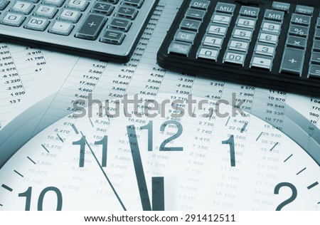 Business time concept, calculators on financial documents and clock - stock photo