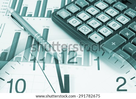 Business time concept, pen and calculator on financial documents and clock - stock photo