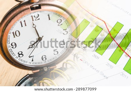 Business time concept with clock and graph documents