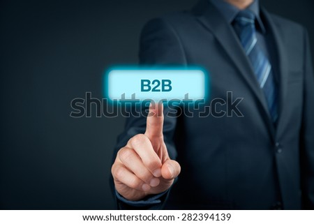 Business to business (B2B) - business model. Businessman click on virtual button with B2B text.