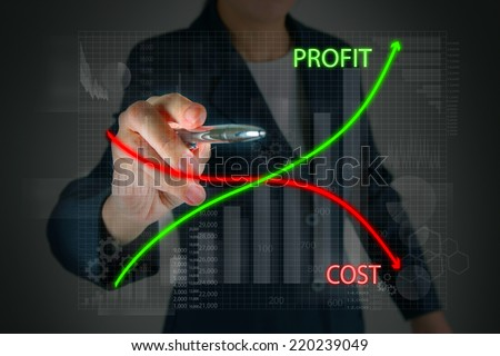 Business touching graph of profit compare with cost - stock photo