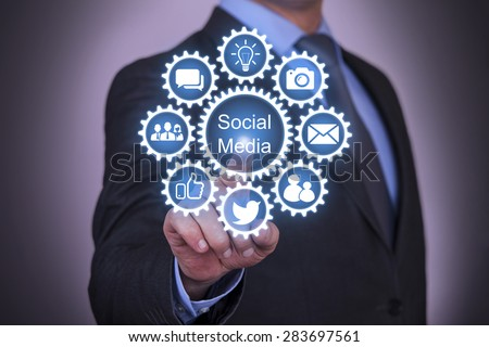 Business Touching Social Media Gear  - stock photo