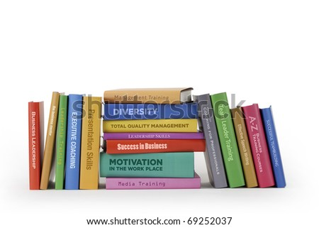 Business training books on white.