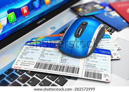 Business travel and web online air tickets booking technology internet concept: wireless computer PC mouse and stack of airline boarding pass, credit cards and passports on laptop or notebook keyboard - stock photo