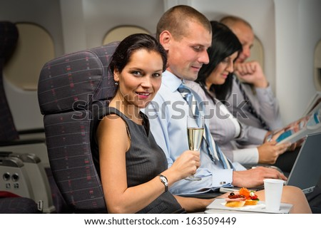 Business travel by airplane woman enjoy refreshment flight cabin passenger - stock photo