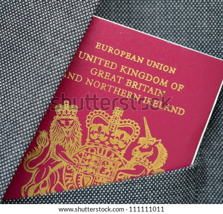 Business Travel Image Of A UK Passport In A Suit Pocket - stock photo