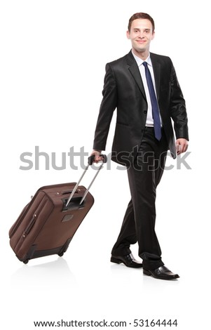 Business traveler carrying a suitcase isolated on white background - stock photo