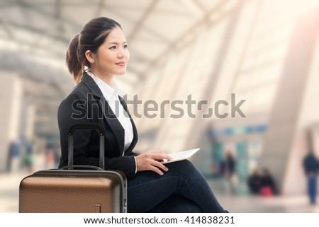business traveler waiting with airport background - stock photo