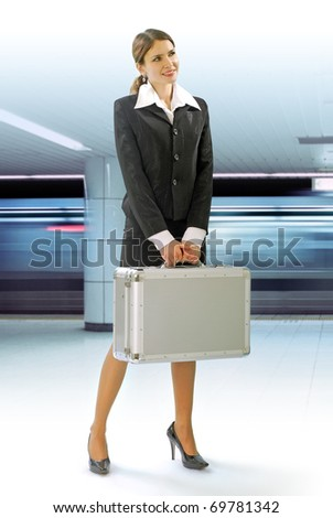 Business traveler with luggage and speed train on station - stock photo