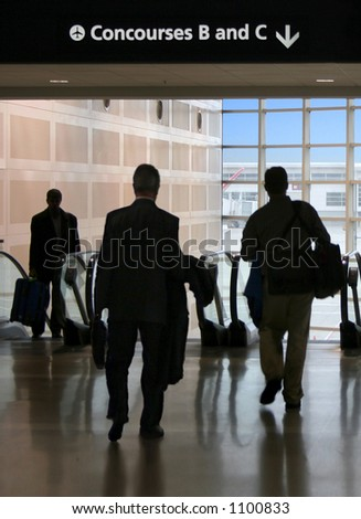 Business travelers head to the gates