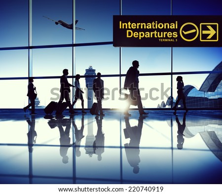 Business Travellers At Airport - stock photo