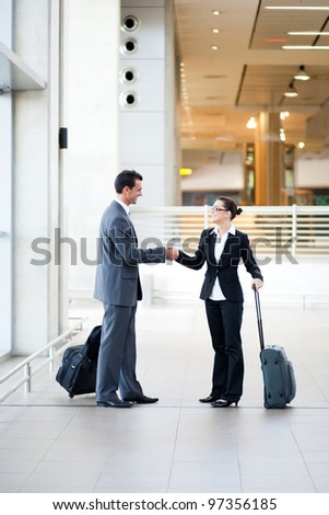 business travellers meeting at airport - stock photo