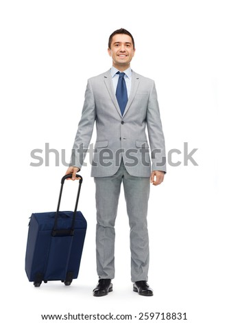business trip, traveling, luggage and people concept - happy businessman in suit with travel bag - stock photo