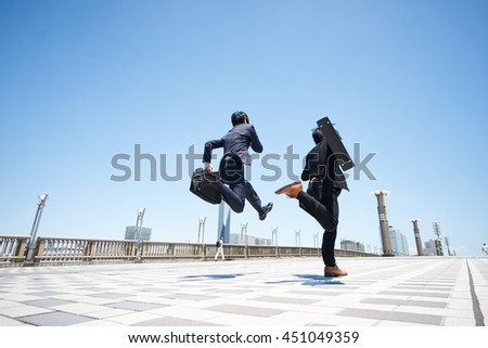 Business two men jumping on the road  - stock photo