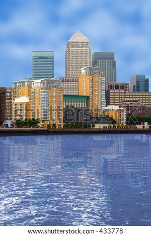 business village view with a river at the front - canary wharf in London, UK - stock photo