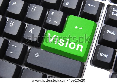 business vision concept with colored key on computer keyboard