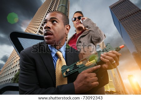 Business war game concept. Businesspeople armed with gun in city. - stock photo