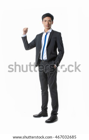 Business winner. Full length of happy young man in forma lwear celebrating, gesturing, keeping arms raised