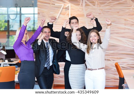 Business winners. Full length of group of happy young people in formal wear celebrating, gesturing, keeping arms raised and expressing positivity - stock photo