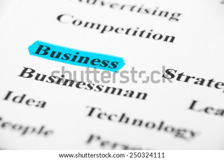 Business with some other related words on paper. - stock photo